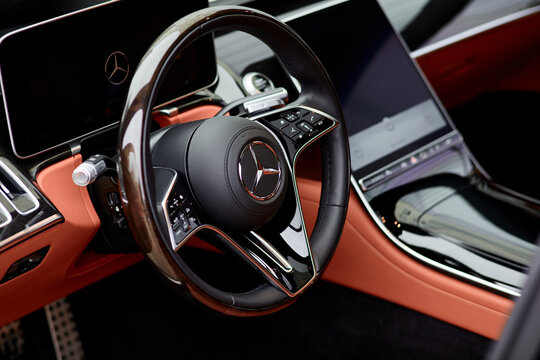 Cabin of luxury Mercedes S Class finished with real wood and leather and a huge multimedia screen MBUX. Katowice,Poland - 02.02.2021