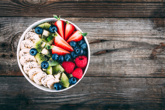 Healthy fresh fruit and berry salad with blueberry, strawberry, kiwi, raspberry, banana and chia seeds