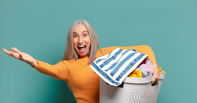 gray hair pretty housekeeper woman washing clothes