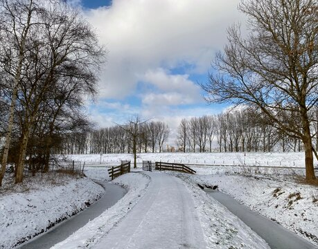 A snow covered road in Spijkenisse, dutch winter in The Netherlands
