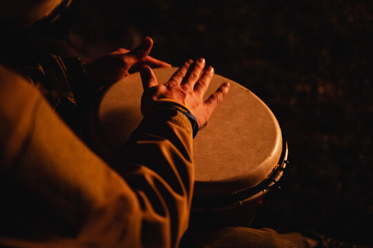 play with your hands on the drum, an African-American plays the djembe drum, top view, close-up