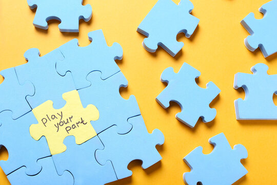 Jigsaw puzzle with phrase Play Your Part on yellow background, flat lay. Social responsibility concept