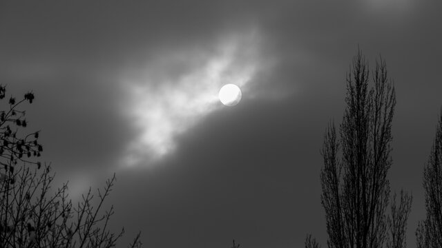 The Sun behind clouds in the sky