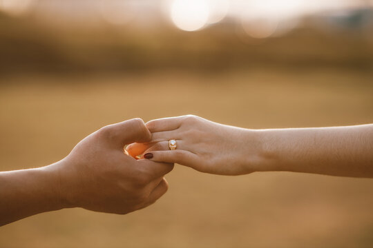 Wedding couple holding hand for getting married. Wedding ring. Engagement. Love. Valentine's day.