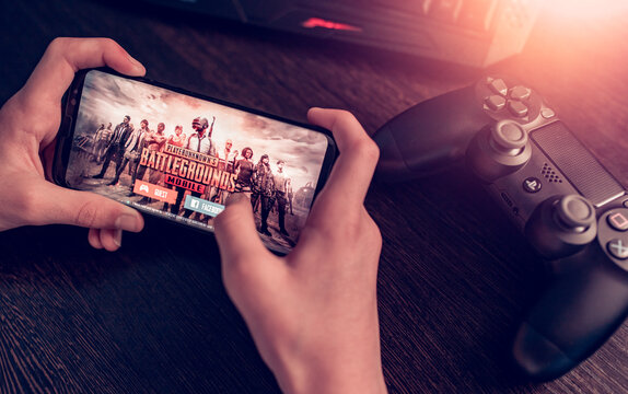 Sarajevo, Bosnia and Herzegovina - February 8, 2021: PlayerUnknown's Battlegrounds or PUBG multiplayer online battle royale game on Samsung Galaxy S8 smartphone in the hands of a boy close-up