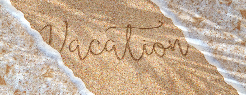 Vacation word written on the sand. Ocean wave rolls on golden beach. Waves, sea foam and sand panoramic background