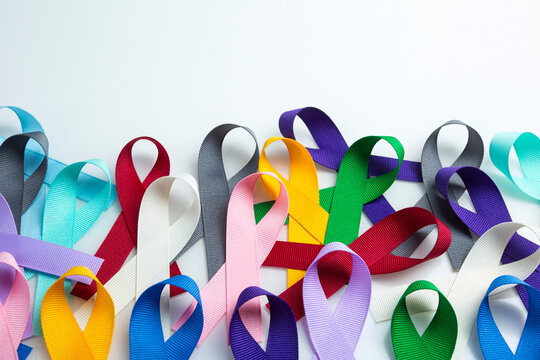 Multi colored cancer ribbon background. Proudly worn by patients, supporters and survivors for world cancer day. Bringing awareness to all types of cancer with copy space