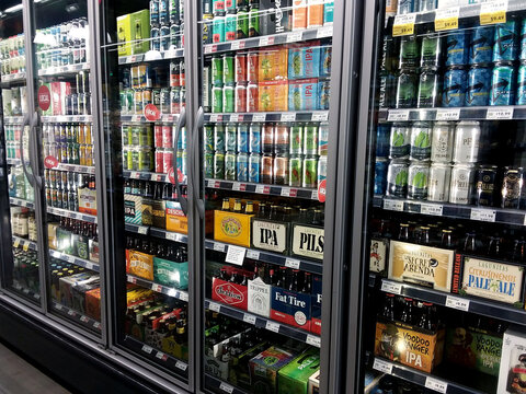 Seattle, WA / USA - June 29st, 2019: Beer and liquor fridge display inside a Whole Foods grocery store.