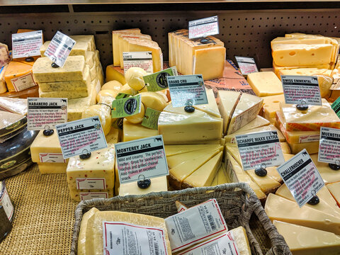 Kirkland, WA / USA - circa December 2019: View of various wedges of cheese on display in the delicatessen inside the Kirkland QFC grocery store, perfect for a charcuterie.