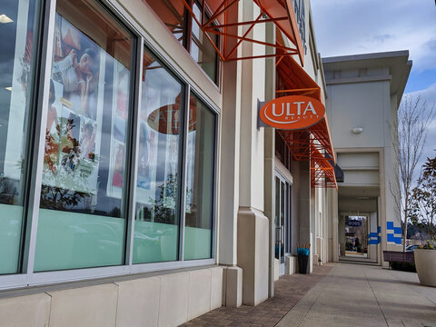 Kirkland, WA / USA - circa March 2020: Angled street view of the entrance to an Ulta Beauty Supply store.