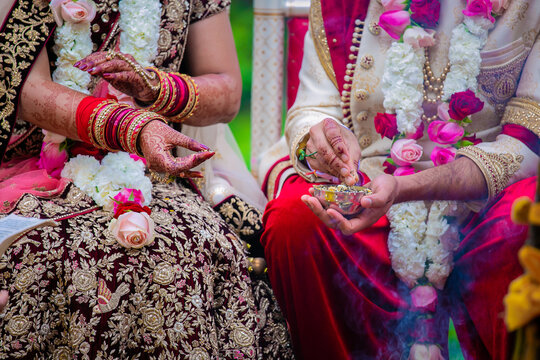 Indian Hindu couple's hands close up, wedding ceremony, religious items and rituals, pooja