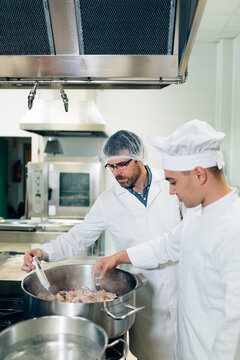 Chef and Quality Inspector checking the Food Temperature