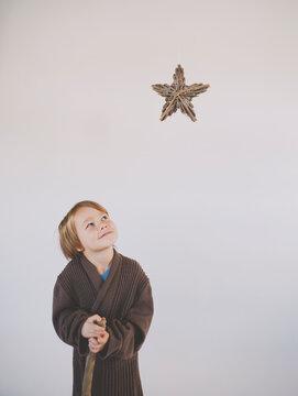 Shepherd looks up at star of bethlehem