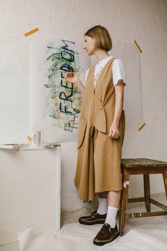 Stylish woman paintingÔøΩ_in studio