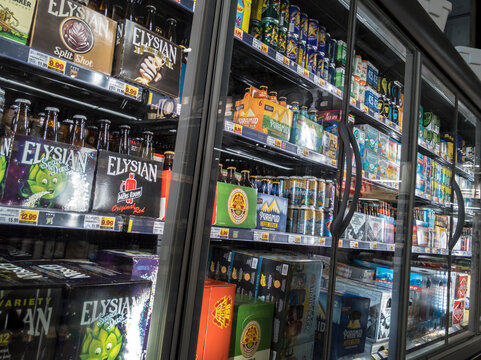 Seattle, WA / USA - circa April 2020: Selective focus on refrtigerated beer display case inside the QFC grocery store, displaying Corona beer and other brands.