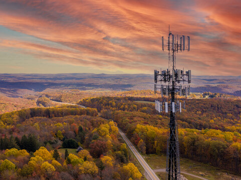 Aerial view of mobile phone cell tower over forested rural area of West Virginia to illustrate lack of broadband internet service