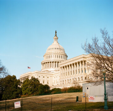 U.S. Capitol Building surrounded by fence reading AREA CLOSED