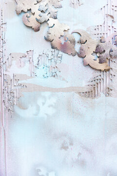 Weathered pastel wall with ornaments
