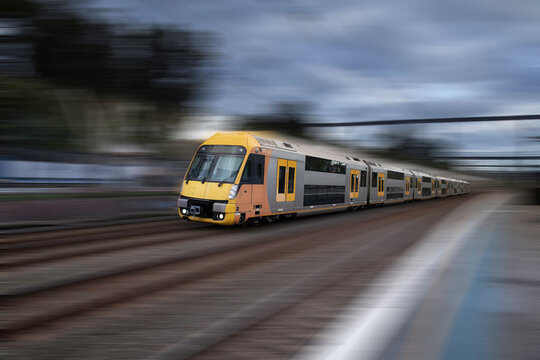 Commuter Train fast moving through a Station in Sydney  NSW Australia