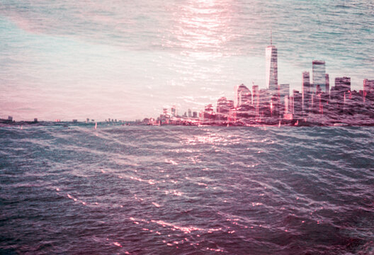 New York City skyline with skyscrapers covered in water at sunset