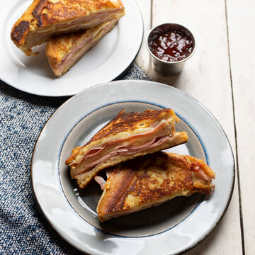 Ham and melted cheese sandwich called Monte Cristo on white background