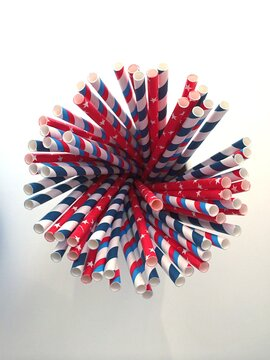 Red, white and blue American patriotic paper bevarage straws in a group