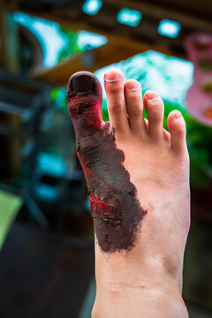 Close up of Zombie's feet with blood. Horror and scary concept. Thriller concept.