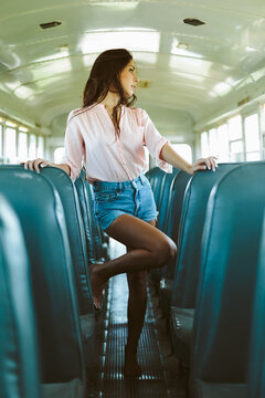 Young pretty woman on an empty bus