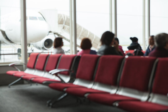 Out of focus image of travelers waiting to board a flight.