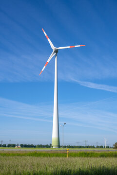 Wind turbine in front of a blue sky in Germany