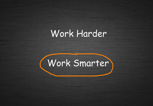 Work harder vs work smarter comparison concept with text in chalkboard