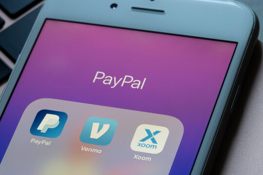 Portland, OR, USA - Feb 9, 2021: PayPal, Venmo, and Xoom apps are seen on an iPhone. Venmo is a mobile payment service, and Xoom is an electronic funds transfer provider, both owned by PayPal.