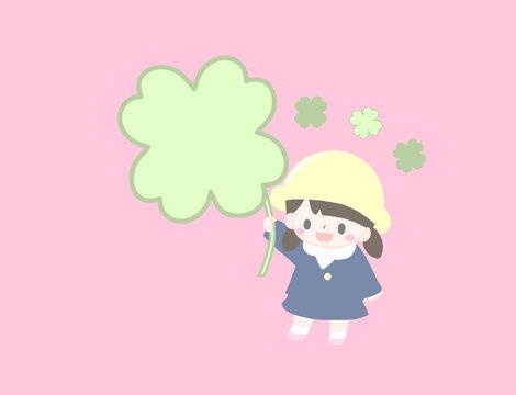 大きな四つ葉のクローバーを持ったかわいい幼稚園児の春の手描き風イラスト