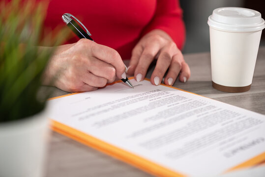 Businesswoman signing a document