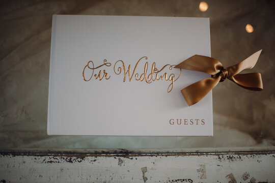 Top view of a guest book for a wedding ceremony on a vintage-style wooden table