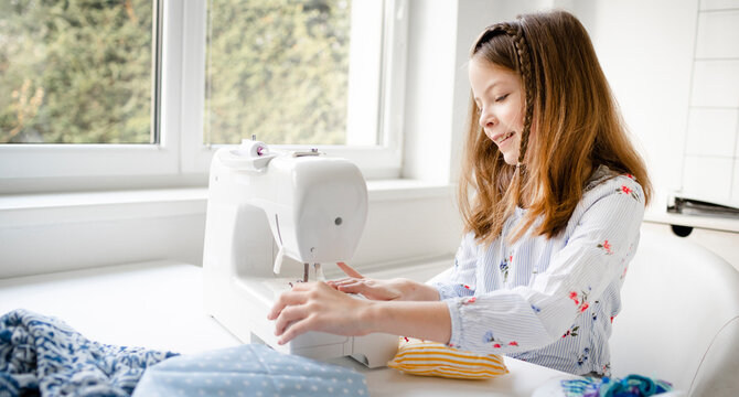 12 years old child studying work with sewing machine
