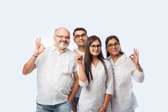 Closeup portrait of Asian Indian family with trendy eye glasses