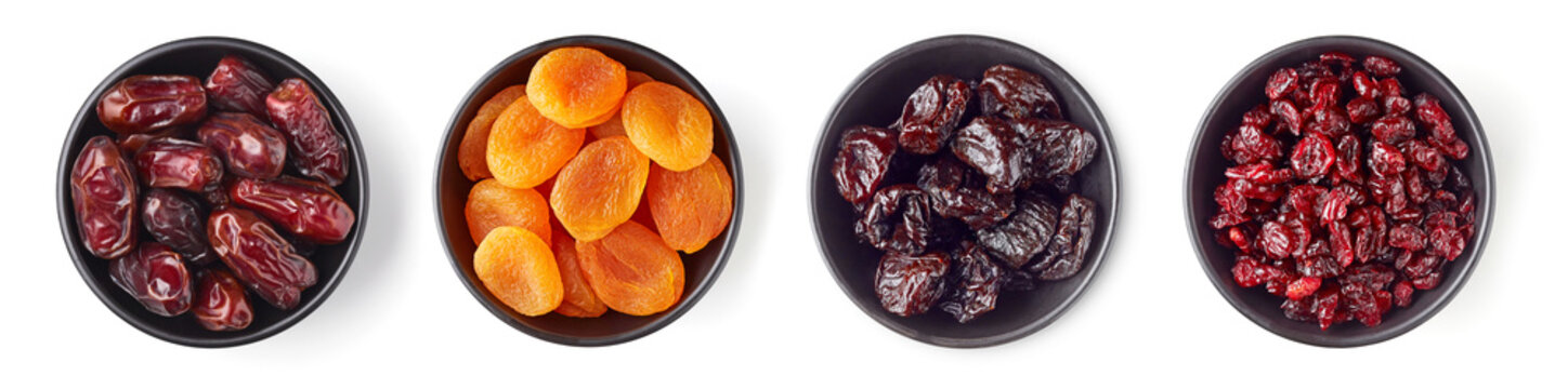 Various dried fruits in bowl isolated on white, from above