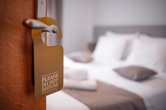 Opened door of hotel room in morning with copy space. please do not disturb. Hotel room , Condominium or apartment doorway with open door in front of blur bedroom background