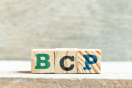 Alphabet letter block in word BCP (abbreviation business continuity plan) on wood background