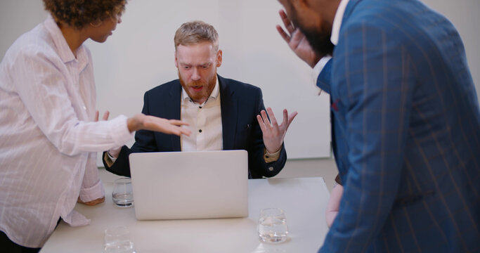 Diverse employees arguing during team meeting shouting at leader