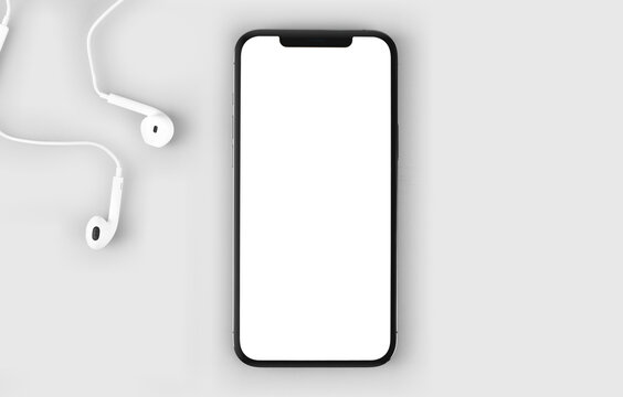smartphone iPhone 12 Pro Max mockup with blank white screen and headphones EarPods, top view. Apple is a multinational technology company. Moscow, Russia - January 14, 2021