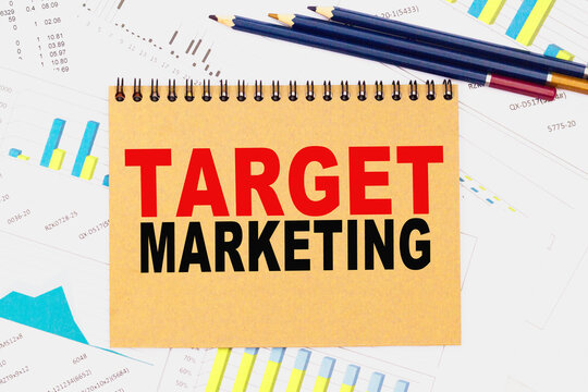 TARGET MARKETING . Office workplace with supplies and reports. You can use in business, marketing and other concepts. Messege of the day.