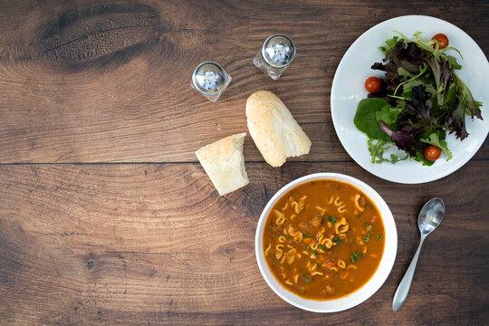 Soup and Salad with room for copy on a Wooden Table