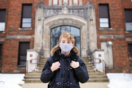 Fifth Grade Boy Child in Covid Face Mask Outside Middle School Education Building