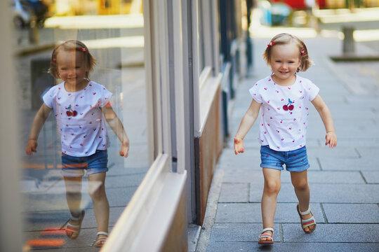Adorable toddler girl having fun outdoors on a sunny summer day