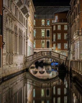 Elegant Venetian buildings reflecting in a canal near Bacino Orseolo, Venice, Italy