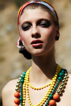Portrait Of Beautiful Woman Wearing Bead Necklaces And Headscarf