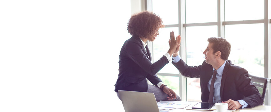 Hispanic and African interracial colleague high five congratulate work banner