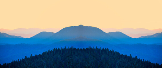 Abstract mirror effect of cascade blue mountains at the morning - View of wilderness mountains during foggy weather Wall mural